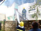 Fire-fighters extinguishing the blaze