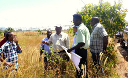 Minister Joseph Harmon (fourth from left) surveys the proposed site for the setting up of a warehouse to store food and other essentials for emergency purposes. (Ministry of the Presidency photo)