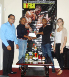 IPA Sales and Marketing Manager, Atisha Isaacs (left) hands over the sponsorship package to Men's Physique champion, Emmerson Campbell in the presence of the company's Managing Director, Reginald Persaud and Telemarketer, Fleur Blanckaert.
