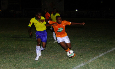 Jermin Junior (right) of Fruta Conquerors trying to maintain possession of the ball while being challenged by a Pele player during their team's GFF Stag Beer Elite League fixture at the Tucville Community ground.