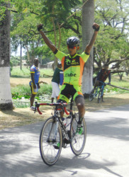Raynauth Jeffrey triumphantly crossing the finish line unchallenged yesterday. (Orlando Charles photo)