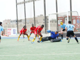 Guyana's Aroydy Branford (centre) in the process of unleashing a shot on the Uruguay goal following a penalty corner during the team's bronze medal matchup in the PAHF Challenge in Chicklayo, Peru. Photo compliments of PAHF Website.