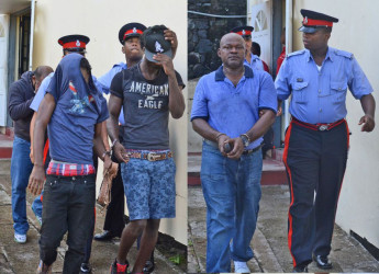 The four Guyanese men leaving court after the charges were read to them. (Grenada Informer photo)