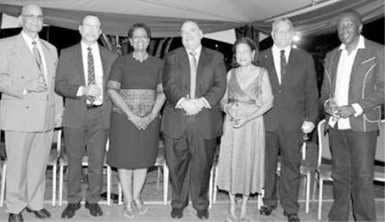 """UWI honorary graduates 2015, from left, Rajkumar """"Krishna"""" Persad, Degree of Doctor of Letters (DLitt); Gerard Besson, Doctor of Letters (DLitt); Marjorie Thorpe, Doctor of Letters; Norman Sabga, Doctor of Letters; Justice Jean Angela Permanand, Doctor of Laws (LLD); Hollis Raymond Charles, Degree of Doctor of Science (DSc), and David Michael Rudder, Doctor of Letters. The grads were guests of honour at a reception hosted by UWI St Augustine Campus Prof Clement Sankat at the office of the campus principal on Friday. PHOTO: ANDRE ALEXANDER"""