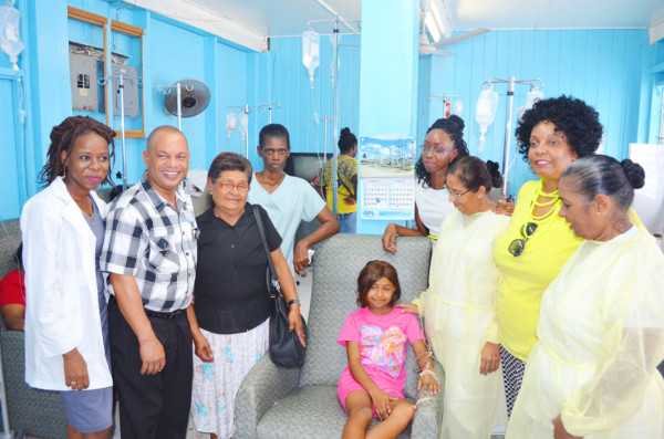 Dr Latoya Gooding (left) and her team pose with Shelly Debidin (centre), the Oncology Consultant (second, left), Shelly's grandmother Celestine DeFreitas (third, left) and members of OSHAG.