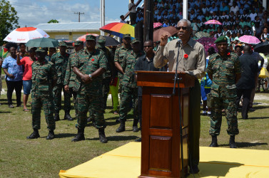 President Granger addressing the troops with the senior officers behind him.