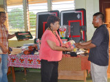Minister Ally hands over one of the items to Sports Chairman at Kurupukari, Mark Holden (GINA photo)