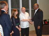Minister of State, Joseph Harmon (right)  shares a light moment with Canadian High Commissioner to Guyana, Pierre Giroux and his wife, Bianca Giroux.  (Ministry of the Presidency photo)