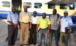 Minister of State, Joseph Harmon (second from left) , with his delegation at the Ogle Airport. At far right is Director General of the Civil Defence Commission (CDC) Colonel Chabilall Ramsarup  (Minister of the Presidency photo)