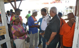Minister of Agriculture Noel Holder interacting with farmers at the Exhibition (GINA photo)