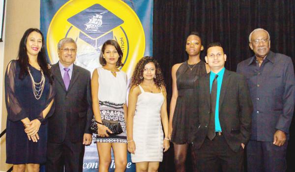 From left are Secretary Sharon Sue-Hang, DDL Chairman Komal Samaroo, Awardees Chelsea Balkarran, Fareeda Bacchus, Natasha Loncke, DDL CFO Vasudeo Singh and DDL Foundation Chairman Rudy Collins. (DDL photo)