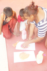 Colouring rice for the Rangoli