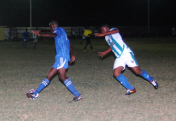 Action between Rosignol United (left)  and Victoria Kings in the GTT Knockout Football Championship at the No. #5 ground in West Berbice
