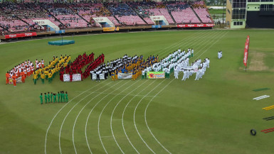 The 16 competing districts assembling to witness the feature address of the 55th National Schools Cycling, Swimming and Track and Field Championships yesterday at the National Stadium.