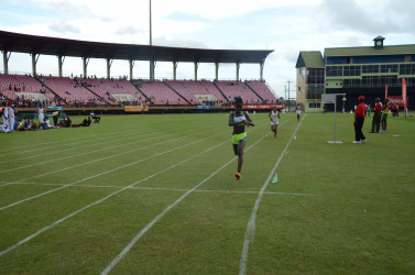 North Georgetown athlete, Claudrice McKoy stops the clock in a brisk 11 minutes and 24.9 seconds after fending off a brief challenge from Margaret Augusto (11m:27.6s) of District 9 to win the under-16 girls 3000m gold yesterday at the National Stadium