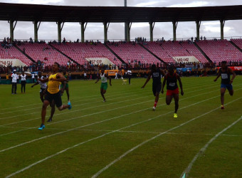 Compton Caesar powering across the line to once again equal the under-18 boys 100m record in 10.7s.