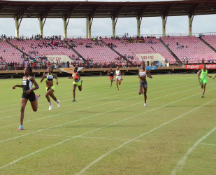 Record breaker, Kenisha Phillips storming to victory in the Girls U-16 200m final to rewrite the record books.