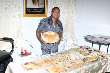 Chhman Sukhaa, of Wooden Memories, displays one of his creations at the Business Exposition 2015, which opened yesterday at the National Exhibition Centre, at Sophia. (Photo by Keno George)