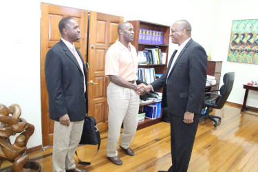 GFF 1st Vice President, Brigadier (rtd.) Bruce Lovell (centre) meets Minister of State Joseph Harmon (right) in the presence of President of the GFF Wayne Forde (Photo courtesy of the Ministry of the Presidency)