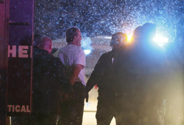 A suspect is taken into custody outside a Planned Parenthood center in Colorado Springs, November 27, 2015. REUTERS/Isaiah J. Downing