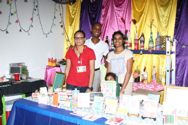 Christine Forrester and her family pose with their products at the Everything Makes Craft booth at Business Expo.