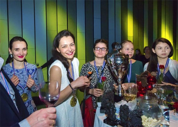 The jubilant Russian women's chess team upon receipt of their trophy and gold medals at the 2015 European Team Chess Championships. The team dominated the Championships through and through scoring eight match wins and one draw in the nine rounds.