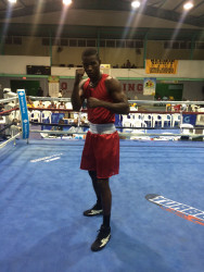 Guyana's captain, middleweight, Dennis Thomas strikes a pose after his round 2 TKO win versus Bahamian, Hubert Fernandes.