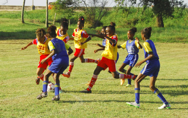 Part of the action yesterday in the2ndSmalta /Ministry of Public Health Girls U-11 Football Championship between North Georgetown and St. Pius at the Ministry of Education ground