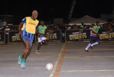 Colin Daniels of defending champs, North Ruimveldt in the process of initiating an attack on the Leopold Street goal during their team's matchup in the Guinness Greatest of the Streets Georgetown Championship at the Demerara Park Tarmac.