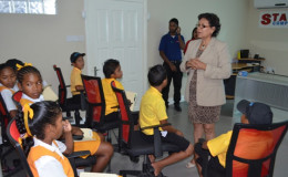 Minister within the Ministry of Indigenous Peoples' Affairs, Valerie Garrido- Lowe engaging the students during their visit to Starr Computers (GINA photo)