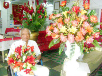 Compton Young In 2010 surrounded by his floral creations