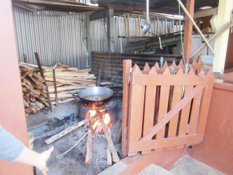 The Fire side utilized by Mohanlall Kissoon to cook his dogfood. His neighbour Narissa Deokarran contends that the smoke from the burning of the wood daily aggravates her allergies, thereby crippling her with respiratory problems.