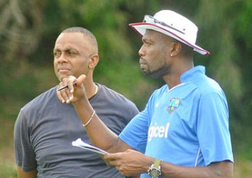 Courtney Walsh (left) chats with former pace partner Curtly Ambrose during a recent West Indies training session in Brisbane. Ambrose is a bowling consultant to the team. (Photo courtesy WICB Media)