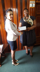 Mohini Somaroo (left) Company Secretary/ Corporate Manager of GNSC Ltd presenting the cheque to Deputy Town Clerk S Jerrick.