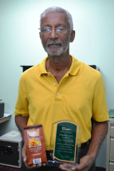 Louis Holder with his product and his GMSA Award