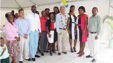 Minister of Education Dr Rupert Roopnaraine (fourth from right) flanked by staff of Cummings Park Nursery and Department of Education, Georgetown. (Ministry of Education photo)