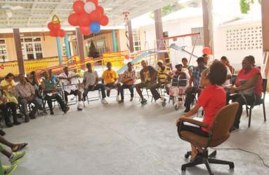 Audrey Moffat speaking with patients (Ptolemy Reid Rehabilitation Centre photo)