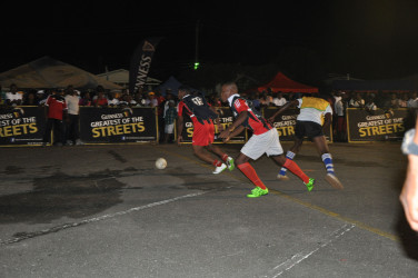 Eon Alleyne (no.19) of Bent Street in the process of initiating an attack alongside team-mate Jermin Junior after stealing the ball from an Old School Ballers player during their team's fixture at the National Cultural Centre tarmac in the Guinness of the Streets Georgetown tournament