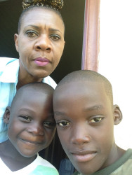 Keith Adams with his older brother Tyrese and would-be adoptive mother, Nan Piggott, in happier times.