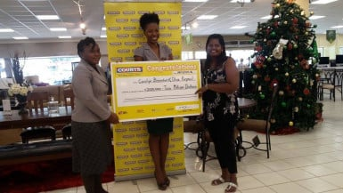 Commercial Manager of Courts, Main Street, Tracy Smith (centre) handing over the cheques to the two winners, Carolyn Brandon (left) and Olive Kirpaul