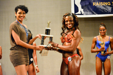 Alisha Fortune collecting her Ms. Best Legs award.