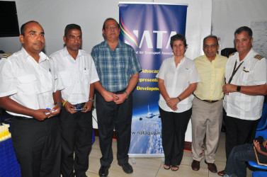 Recipients Captain Gary Sahai (left), Supervisor of Operations Bholanauth Baijnath (second, left) and Director of Aviation Safety Regulations Ankar Doobay pose with NATA President Annette Arjoon-Martins (third, right), Vice President, Captain Gerry Gouveia (right) and Vice Chairman of the Private Sector Commission Edward Boyer (second, right).