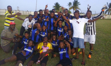 The victorious Uitvlugt Warriors team following the conclusion of the match against Pouderoyen FC