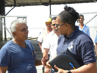 Minister Annette Ferguson (right) speaking to a resident. (Ministry of Public Infrastructure photo)