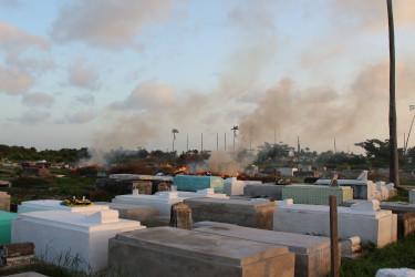 Debris being burned in Le Repentir Cemetery. (Photo by Keno George)