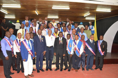 President David Granger  (seventh from right in front row) flanked by some of the men honoured by the National Association of Adventist Men's Ministry for their longstanding service and dedication.  (Ministry of the Presidency photo)