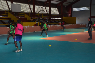 GFF Technical Director Claude Bolton (right) in the process of supervising a part of the session during the opening day of trials to short-list the Futsal squad