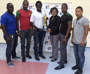 Second VP of the GRFU, Joshua Griffith pose with the GTT 10s championship trophy in the presence of the captains of The Pepsi Hornets, GDF, UG Wolves and the GPF.