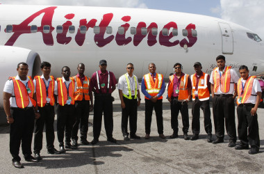 Students and lecturers of the new Air Services Limited Aeronautical Engineering School and instructors from Caribbean Airlines on the CJIA tarmac, at Timehri yesterday. ASL Marketing Manager Annette Arjoon-Martins is fourth from the right. (Photo courtesy of ASL)