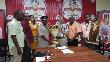 President of the GFA, Clifton Hickens (fourth from right) collecting the championship trophy from Banks Beer Brand Manager Brian Choo-Hen following the conclusion of the launch ceremony while other members of the GFA and Banks DIH Limited look on.